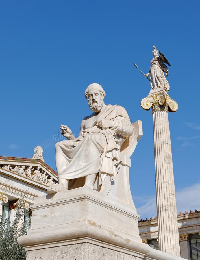 Athens Greece, Plato the philosopher and Athena ancient goddess statues. Under crystal clear blue skyn stock photo