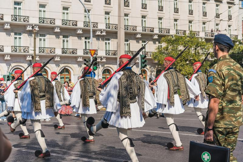 ATHENS, GREECE - SEPTEMBER 16, 2018: The Evzones - historical elite unit of the Greek Army that guards the Greek Tomb of the. Unknown Soldier and the stock image