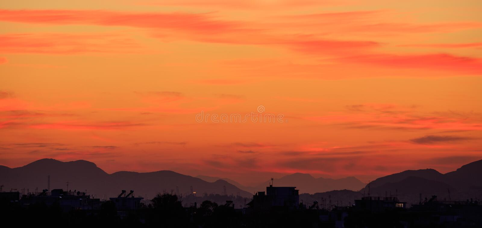 Athens, Greece. Sunset over hills silhouette royalty free stock images
