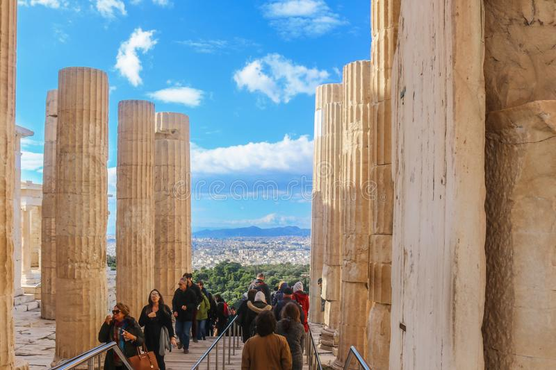 1-12-2018 Athens, Greece- Tourists exiting and entering the Parthenon complex on the Acropolis in Athens in the winter with Athens royalty free stock images