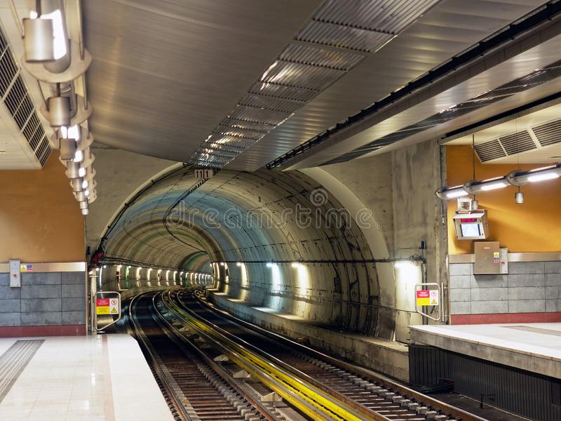 Athens Metro Tunnel and Platforms, Greece. View of an Athens Metro line tunnel and train tracks leading into the platform area, Greece royalty free stock images