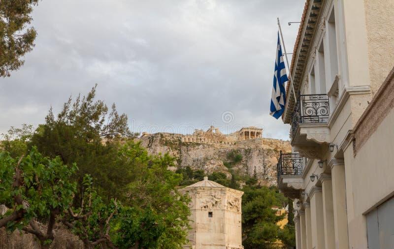 Athens, Plaka district view with flag, Roman Agora and Acropolis stock photography
