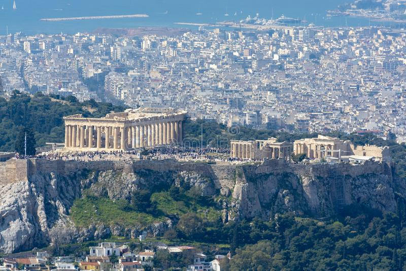 Athens in spring, view from hill,  cityscape with Acropolis, streets and buildings, ancient urbal culture. Athens, capital of Greece, in spring, view from hill royalty free stock photography