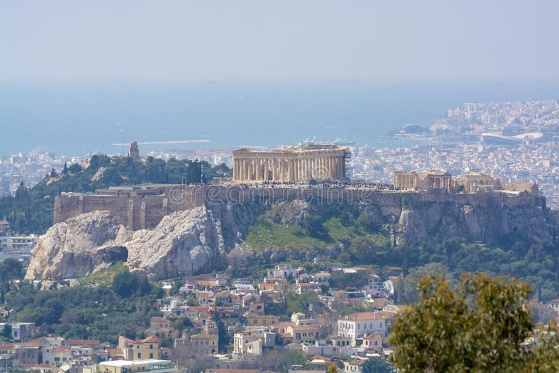 Athens in spring, view from hill,  cityscape with Acropolis, streets and buildings, ancient urbal culture. Athens, capital of Greece, in spring, view from hill royalty free stock images