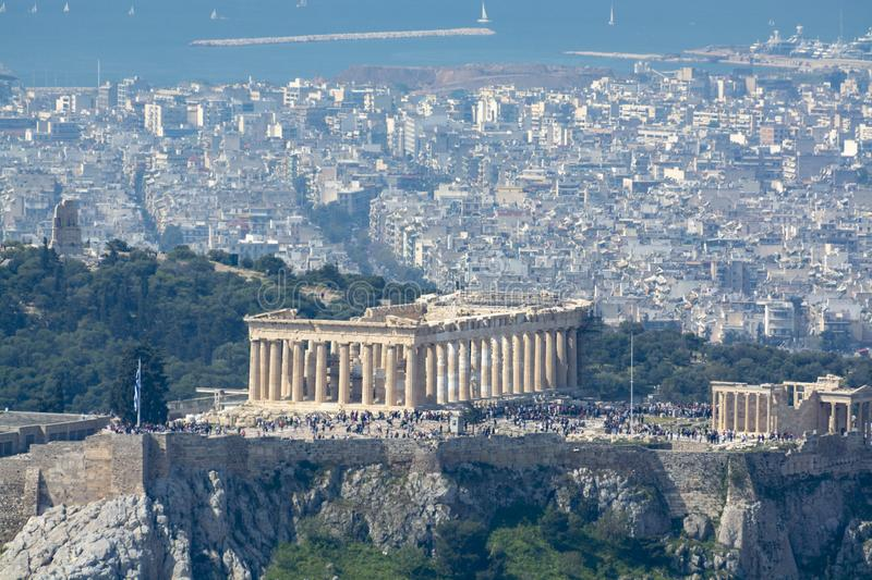 Athens in spring, view from hill,  cityscape with Acropolis, streets and buildings, ancient urbal culture. Athens, capital of Greece, in spring, view from hill royalty free stock image