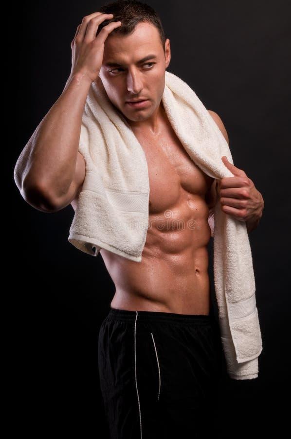Athlète avec l'essuie-main. image stock
