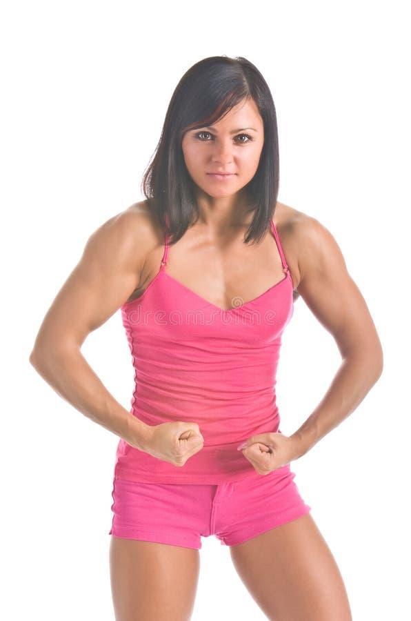 Athlète féminin fléchissant ses muscles images stock