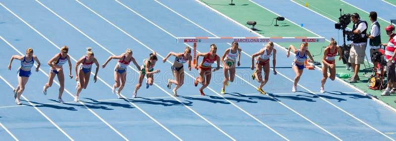 Athlètes de femmes dans l'action photographie stock libre de droits
