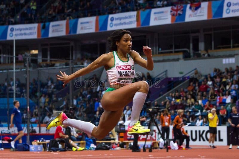 Athlétisme - saut triple de femme, MAMONA Patricia images libres de droits
