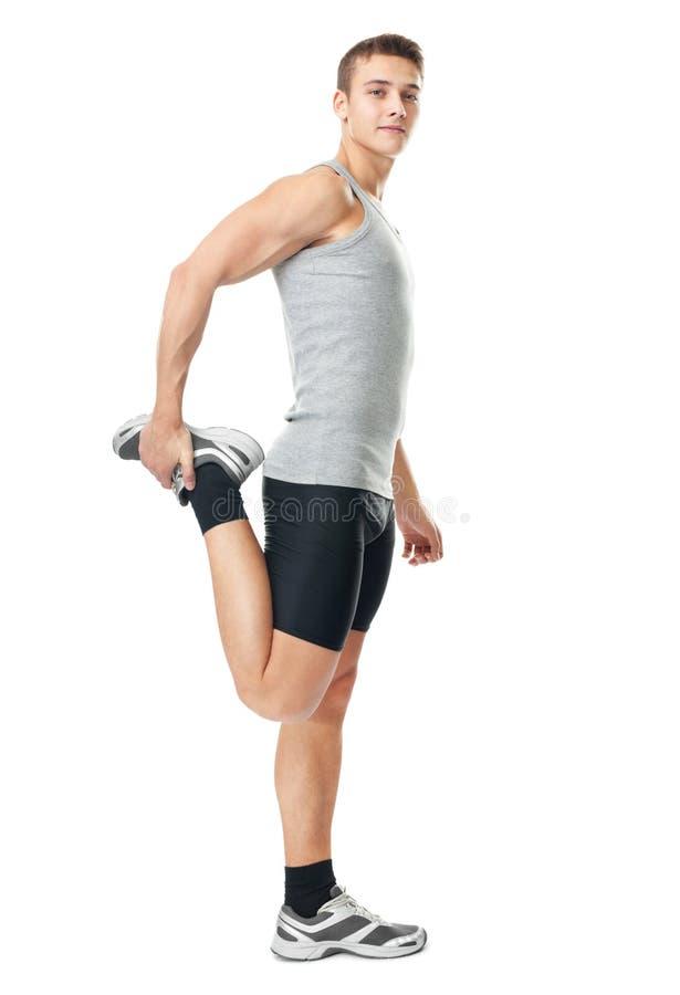Athlet, der Ausdehnungsübungen tut lizenzfreies stockfoto