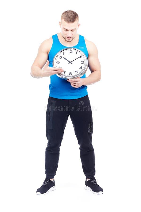 Athlet, der Uhr hält stockfotos