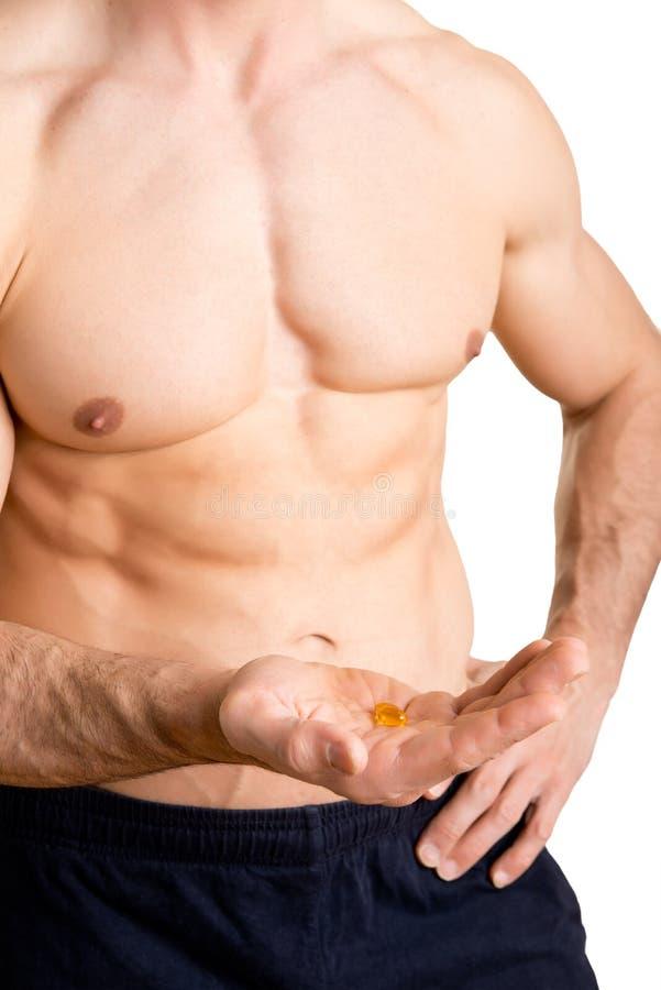 Athlet Taking Supplements lizenzfreies stockfoto
