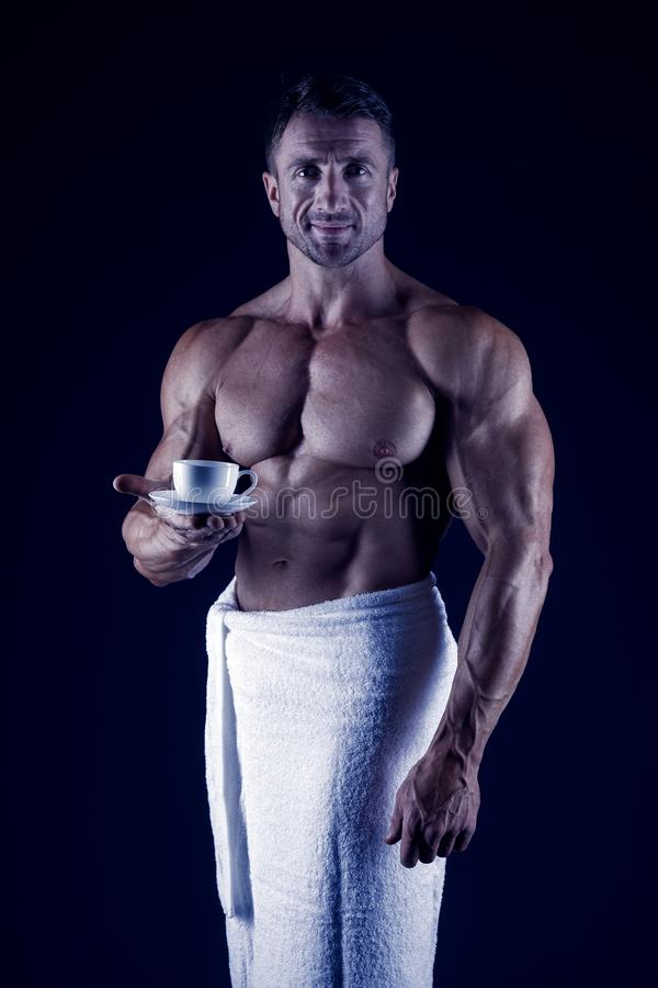 Athlete with bare torso. Sexy man in bath towel. muscular body man after shower. morning relax. morning coffee royalty free stock photography