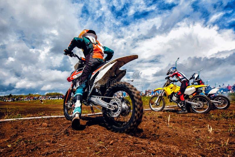Athlete bikers is start motocross stock photos