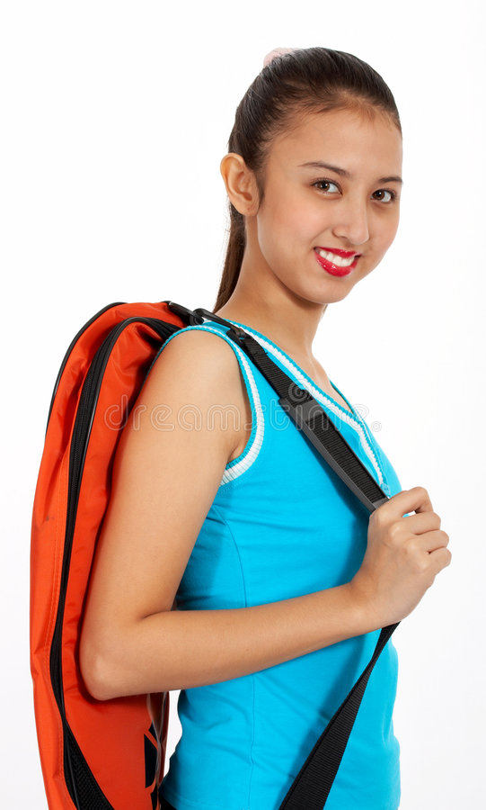 Athlete carrying a racket bag