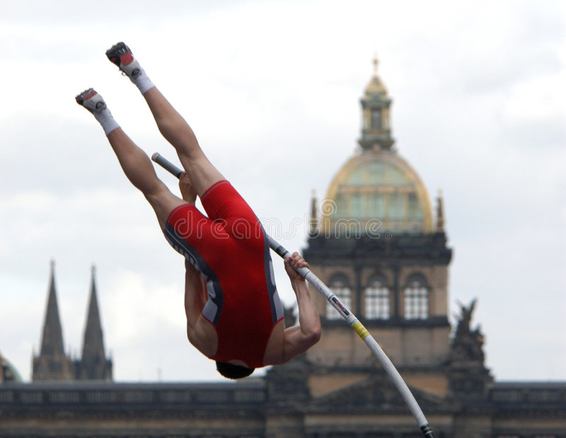 Athlete Clearing the Bar. An athlete clearing the bar during a pole vault event in Prague, Czech Republic stock images