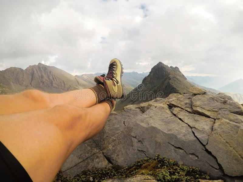 Beautiful legs against the background of mountain peaks stock images