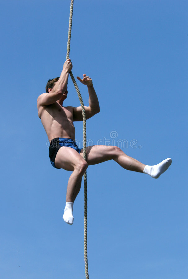 Download Athlete Climbing Up The Rope Royalty Free Stock Image - Image: 520786
