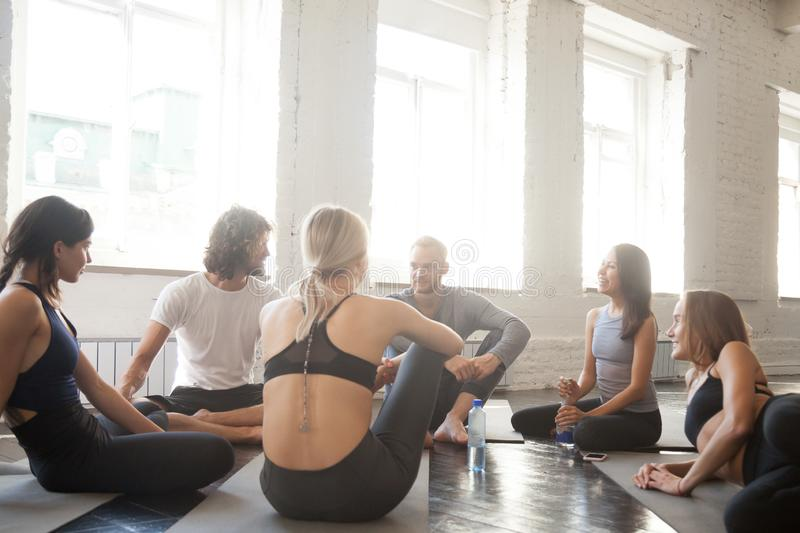 Athlete community talking in a circle during a break royalty free stock photo