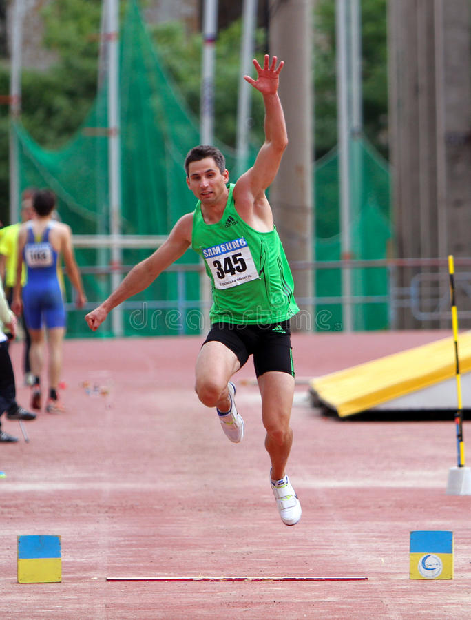 Athlete Compete In Triple Jump Editorial Stock Image