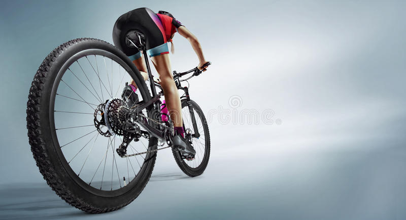 Athlete cyclists in silhouettes on white background. Sport. Athlete cyclists in silhouettes on white background. Isolated stock photo