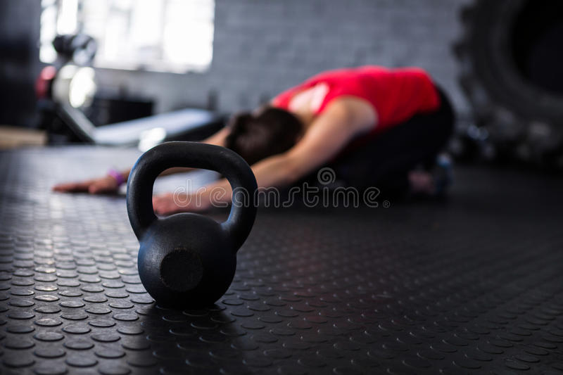 Athlete exercising by kettlebell stock photos