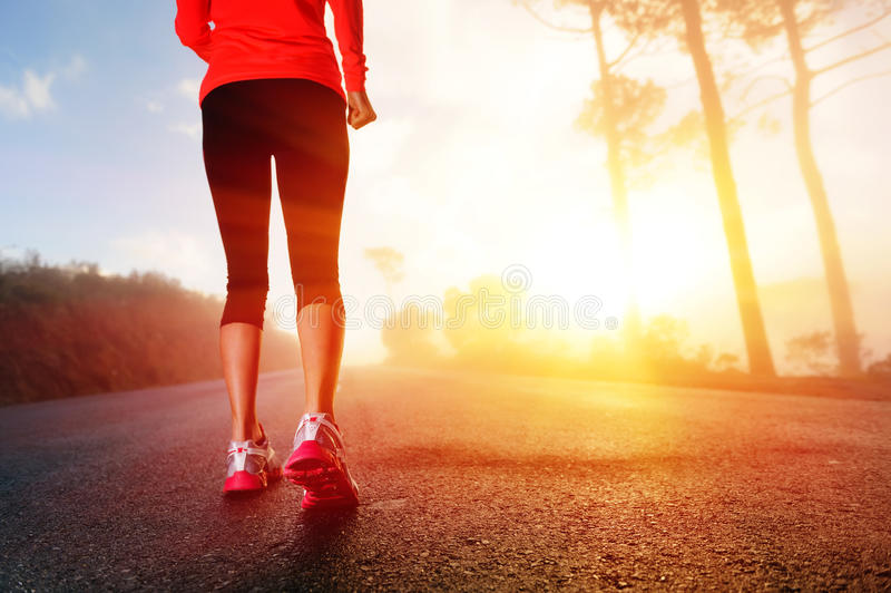 Athlete feet on road stock images