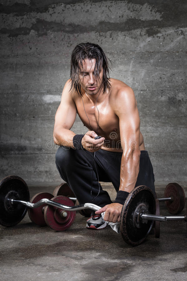Athlete fine tuning his music player royalty free stock photo