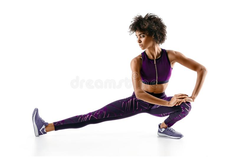 Athlete girl stretching her hamstrings royalty free stock photography