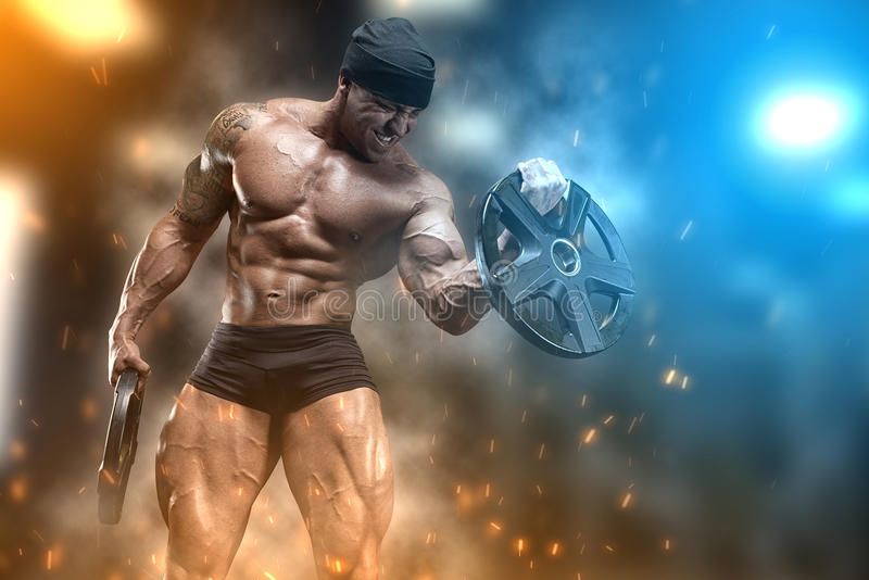 Athlete in the gym royalty free stock photography