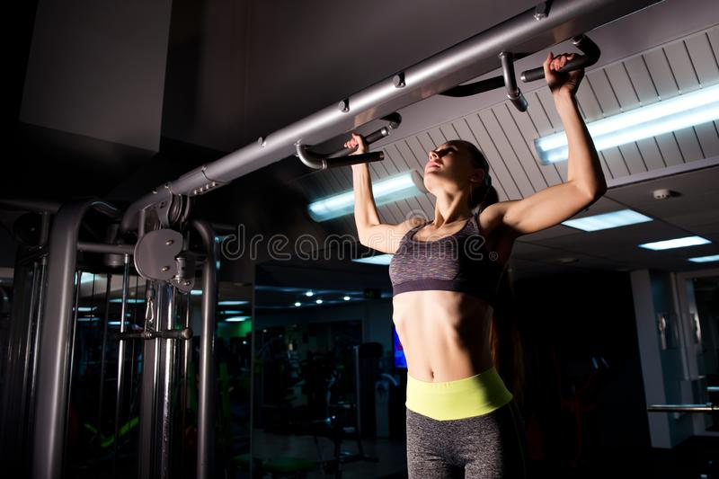 Athlete in the gym pulls up on the bar. Looking up royalty free stock photos
