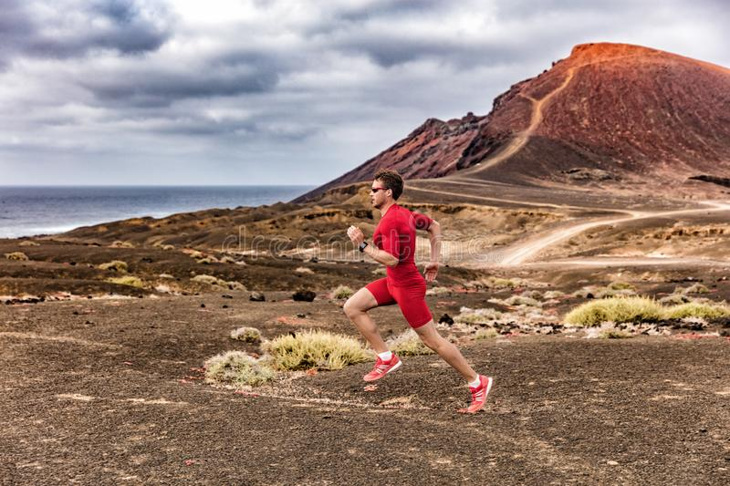 Athlete health and fitness trail runner man running in desert outdoor wearing compression clothes. Sport endurance training man royalty free stock photos