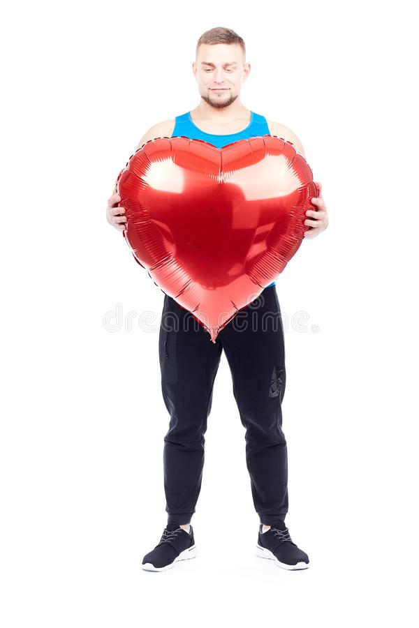 Athlete with heart-shaped balloon stock photo
