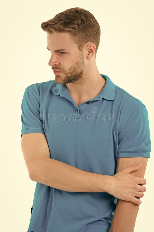 Athlete injured elbow joint. Man suffers old trauma chronic pain elbow white background. Sportsman risks taker. Exercising physical trauma. Guy painful face stock image