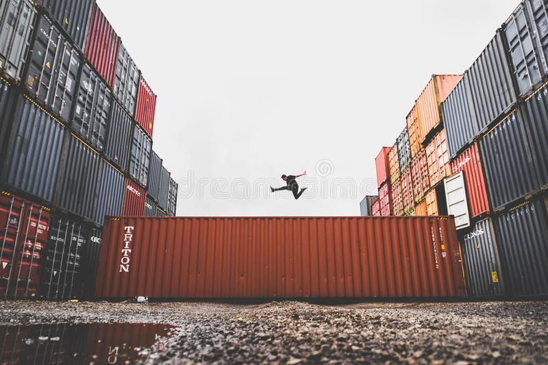 Athlete jumping over containers