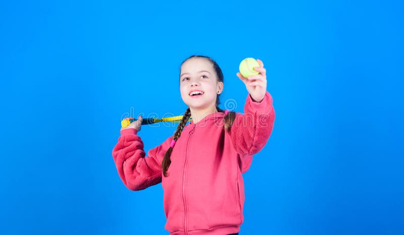 Athlete kid tennis racket on blue background. Active leisure and hobby. Tennis sport and entertainment. Girl adorable. Child play tennis. Practicing tennis royalty free stock photography