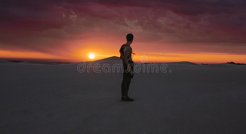Athlete looking at desert sunset royalty free stock images