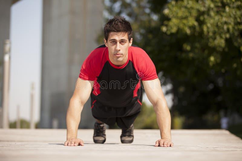 Athlete making some pushup stock photography