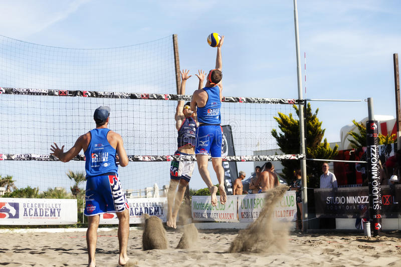 Athlete man beach volleyball jumping spike attack. Defense. royalty free stock images