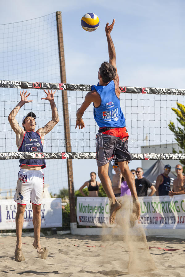 Athlete man beach volleyball jumping spike attack. Defense. royalty free stock photo
