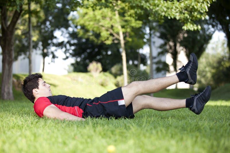 Athlete man making abdominals stock image