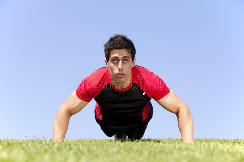 Download Athlete man making pushups stock photo. Image of athletic - 19878854