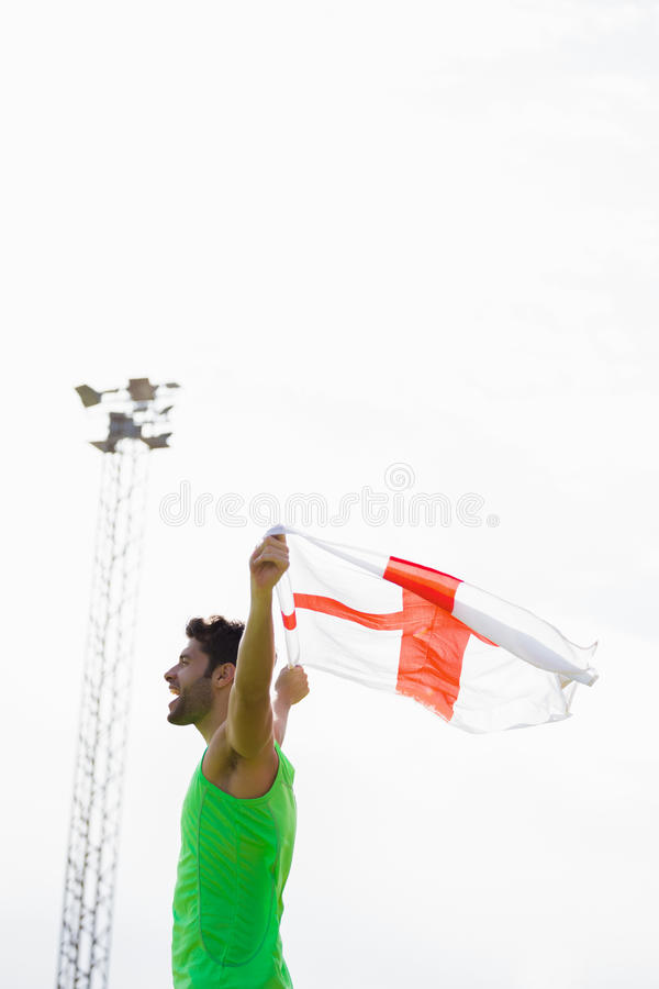 Athlete posing with england flag after victory stock photo