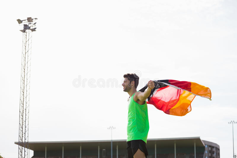 Athlete posing with german flag after victory royalty free stock images