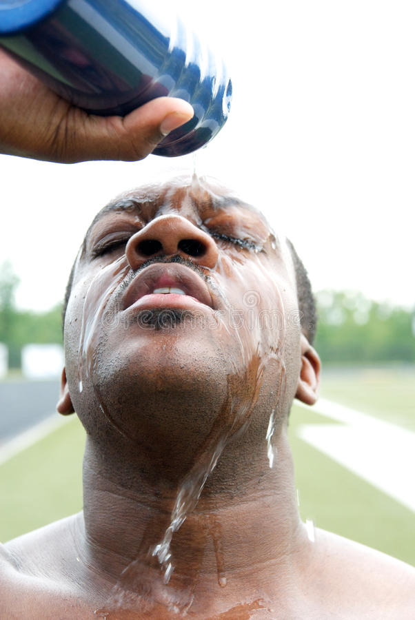 Athlete pouring water on face royalty free stock photos