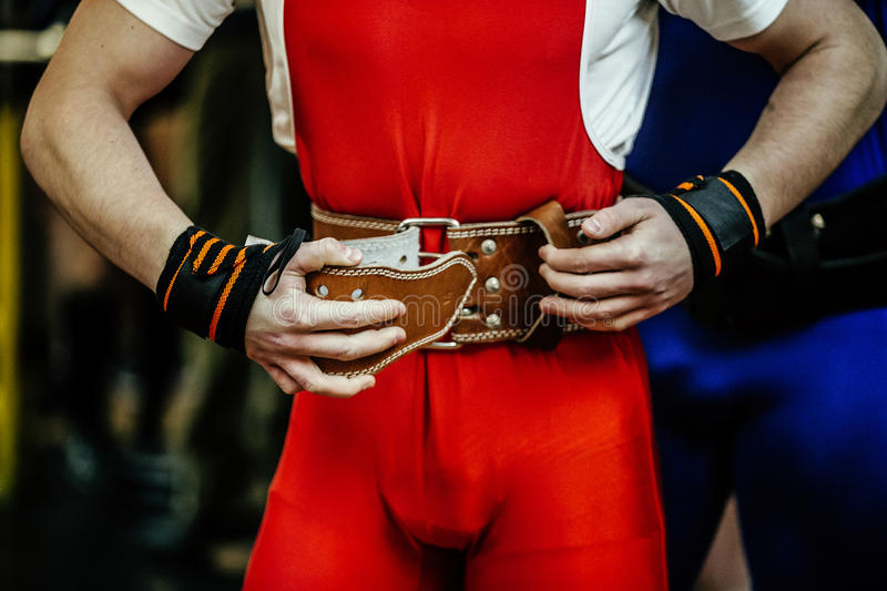 Athlete powerlifter buckles power. Belt competition powerlifting stock photography