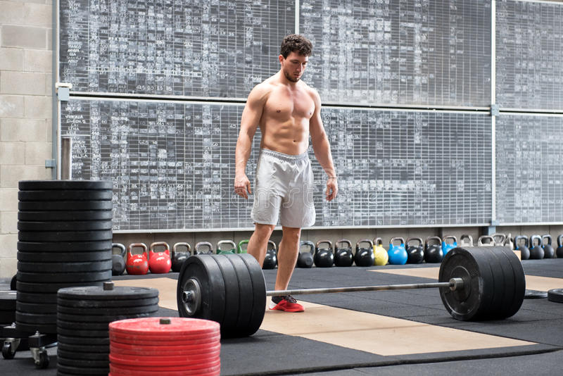 Athlete psyching himself up before lifting weights royalty free stock image