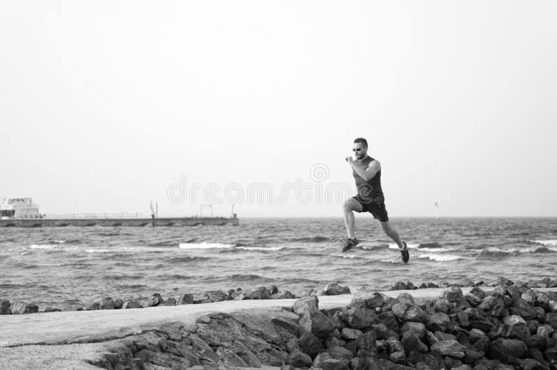 Athlete runner along sea coast. running to success. summer vacation. copy space. speed concept. goal and future. people stock photo