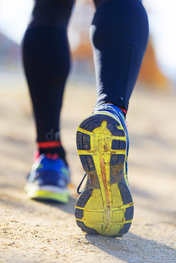 Athlete runner feet running in nature, closeup on shoe. stock photography
