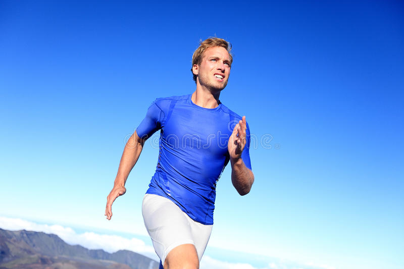 Athlete runner sprinting running to success stock photography